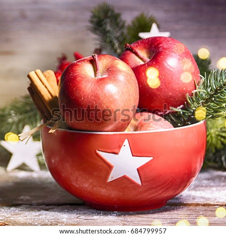 Rustic Christmas background with red apple