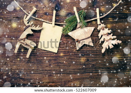 Rustic Christmas decoration on textured wooden background #522607009