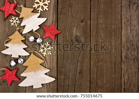 Rustic Christmas Side Border With Wooden Ornaments Over An Aged Wood Background 755014675