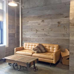 Rustic coffee table and cozy lounge space with wooden walls