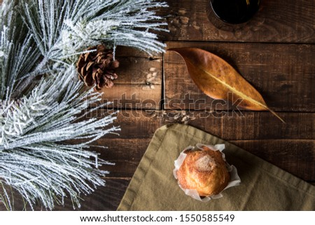 Rustic cupcake on rustic wooden background
