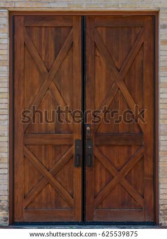 Rustic Double Wooden Door on brick building