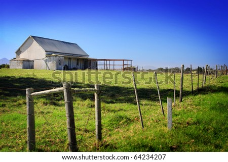 rustic farm shack workshop with pasture