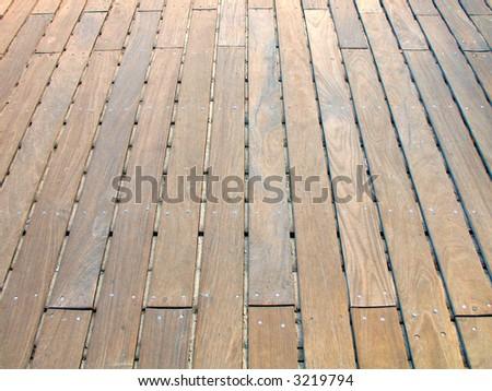 Rustic floor boards on boardwalk - stock photo