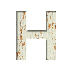 Rustic font. The letter H cut out of paper on the background of old rustic wall with peeling paint and cracks. Set of simple decorative fonts