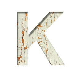 Rustic font. The letter K cut out of paper on the background of old rustic wall with peeling paint and cracks. Set of simple decorative fonts