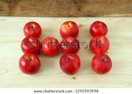 Rustic hi word. Apples word hi. The word hi is made up of red apples on a wooden table #1295993998