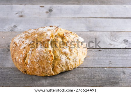 rustic homemade loaf on weathered natural wood table