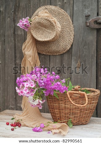 Rustic image of a gardener's straw hat and basket