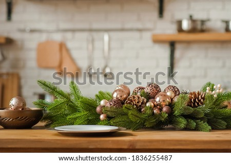 Rustic kitchen details for Christmas. Rustic kitchen table setting and decor for New Year close-up and copy space. Selective focus.