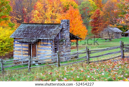 Rustic log cabins in a fall setting located at Grayson State Park in Virginia.  Rainy, overcast day.