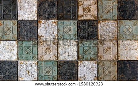 Rustic looking pressed tin antique ceiling tiles with oriental pattern, a beautiful background Stock photo ©