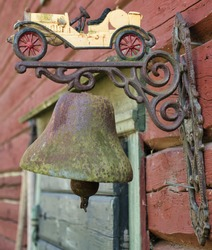 rustic metal bell with car decorated