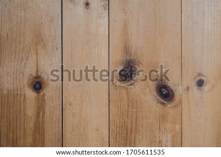 Rustic, natural,  knotty pine boards on a wall in a vertical composition Stock photo ©