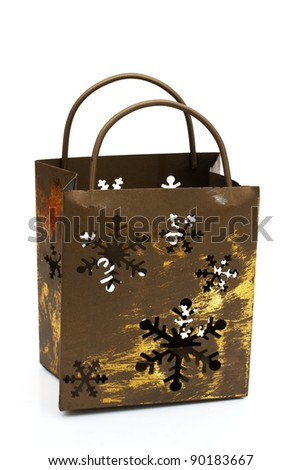 Rustic old metal gift bag isolated on white, Christmas Time