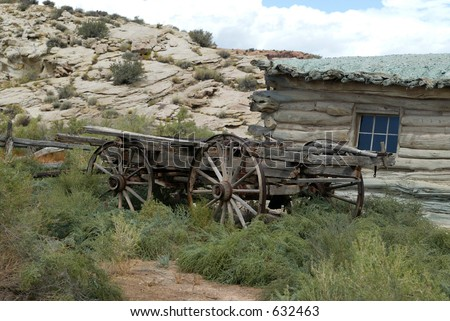 rustic old wagon by house
