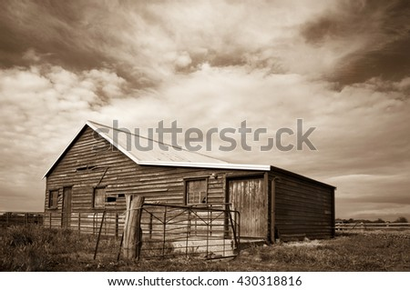 Rustic old wooden shearing shed in monotone in rural Victoria, Australia.