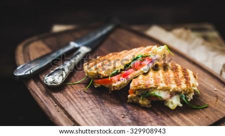 rustic panini on wooden board, selective focus Stok fotoğraf ©