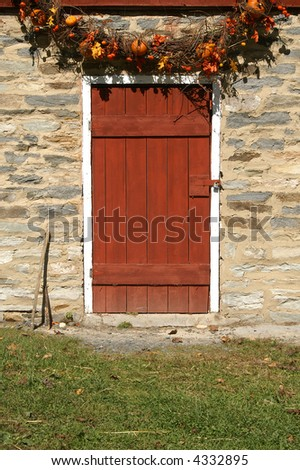 Rustic Red Barn Door with Autumn Wreath Detail