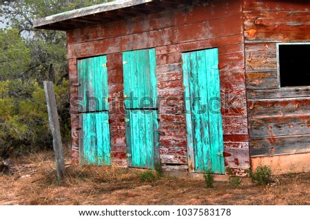 Rustic Red Barn Has Three Sets Of Double Doors Painted Turquoise Paint Is Weathered