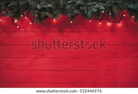 Photo of Rustic red Christmas wooden background.Happy New Year 2019 tree branch,garland light on wood wallpaper.Bright winter holiday banner with copyspace to place text.Stock photo back ground for poster