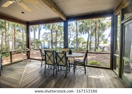 rustic screen porch with forest and waterfront view #167153186