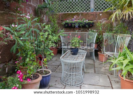 Rustic seating in the English courtyard garden