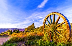 Rustic spoked wagon wheel in nature scene
