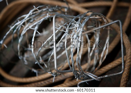 Rustic still life of barbed wire and rope