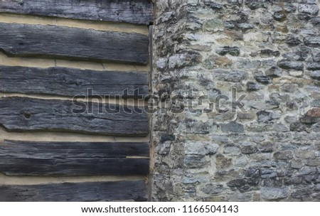 Rustic Stone and wood background of old log cabin divided stone fireplace-grey dark and light textures