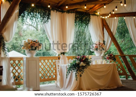 rustic table in rustic style with garland and fresh flowers