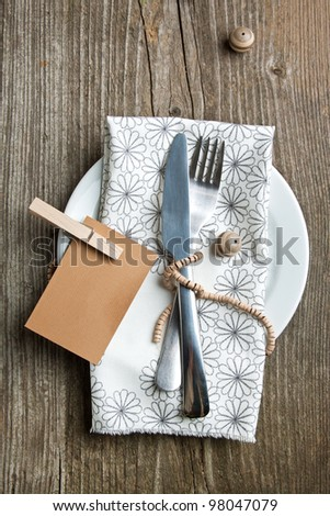Rustic table setting on old wooden table with wooden decor