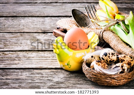 Rustic table setting with quail eggs for Easter holiday