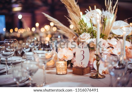 rustic wedding decorations with flowers and candles. banquet decor. picture with soft focus #1316076491
