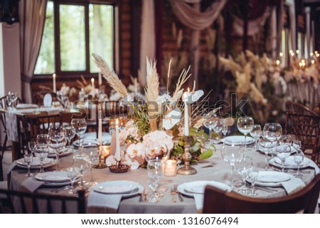 rustic wedding decorations with flowers and candles. banquet decor. picture with soft focus #1316076494