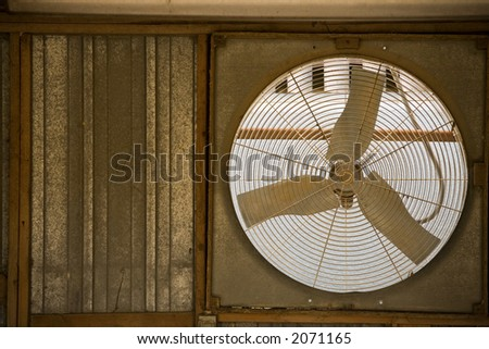 Rustic window fan in an old garage