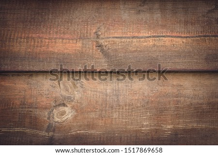 Rustic wood background. Brown wooden planks. Horizontal lines on dirty wall, fence. Vintage timber plank, scratched surface. Grunge texture. Shabby table. Pattern of oak table.