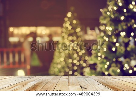 rustic wood table in front of christmas light night,abstract circular bokeh background