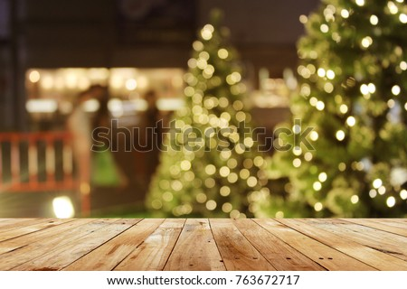 rustic wood table in front of christmas light night,abstract circular bokeh background  #763672717