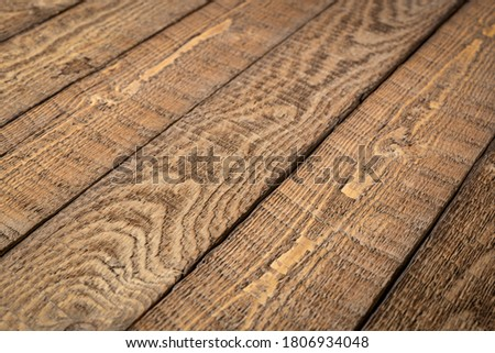 Photo of  rustic wooden background - diagonal planks of weathered pine wood with strong grain, sawing  pattern and knots