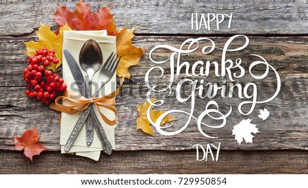 Rustic Wooden Background With Cutlery Arrangement Autumn Leaves And Hand Drawn Lettering Happy Thanksgiving Day Vintage Style Calligraphy