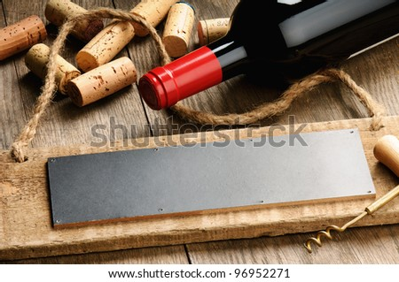 Rustic wooden board, wine and corks