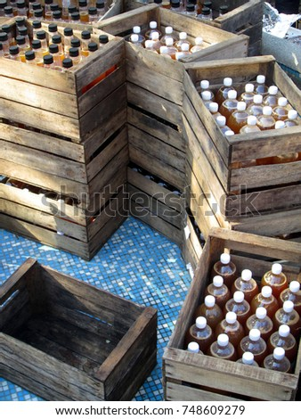 Rustic wooden crates of apple juice plastic bottles #748609279