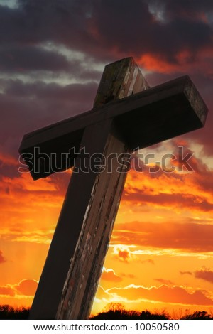 Rustic Wooden Cross Against Dramatic Sunset Sky