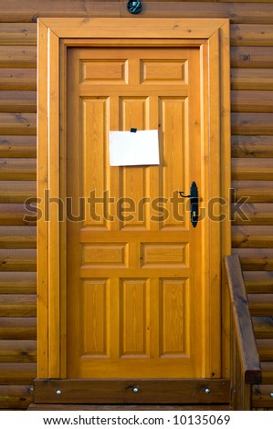 Rustic wooden door with a sign blank