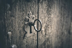Rustic wooden door with old key