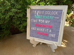 Rustic wooden restaurant or pub sign or menu. Funny, inspirational or motivational quote, saying or meme. Felt letter board with multicolored letters on concrete, sidewalk or pavement.