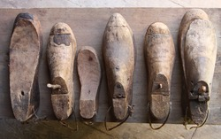Rustic wooden shoe lasts on wooden surface