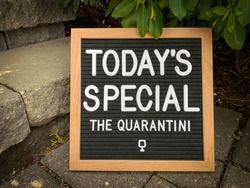 Rustic wooden sign with a daily special spelled out: