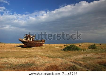 rustig ship in aral desert / lake , Kazakhstan